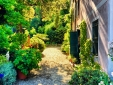 Gardens and path in fornt of Il Giardino and la capella